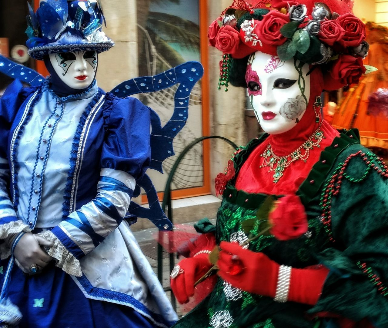 mask - disguise, venetian mask, costume, carnival - celebration event, real people, carnival, mask, waist up, front view, two people, disguise, celebration, outdoors, arts culture and entertainment, day, lifestyles