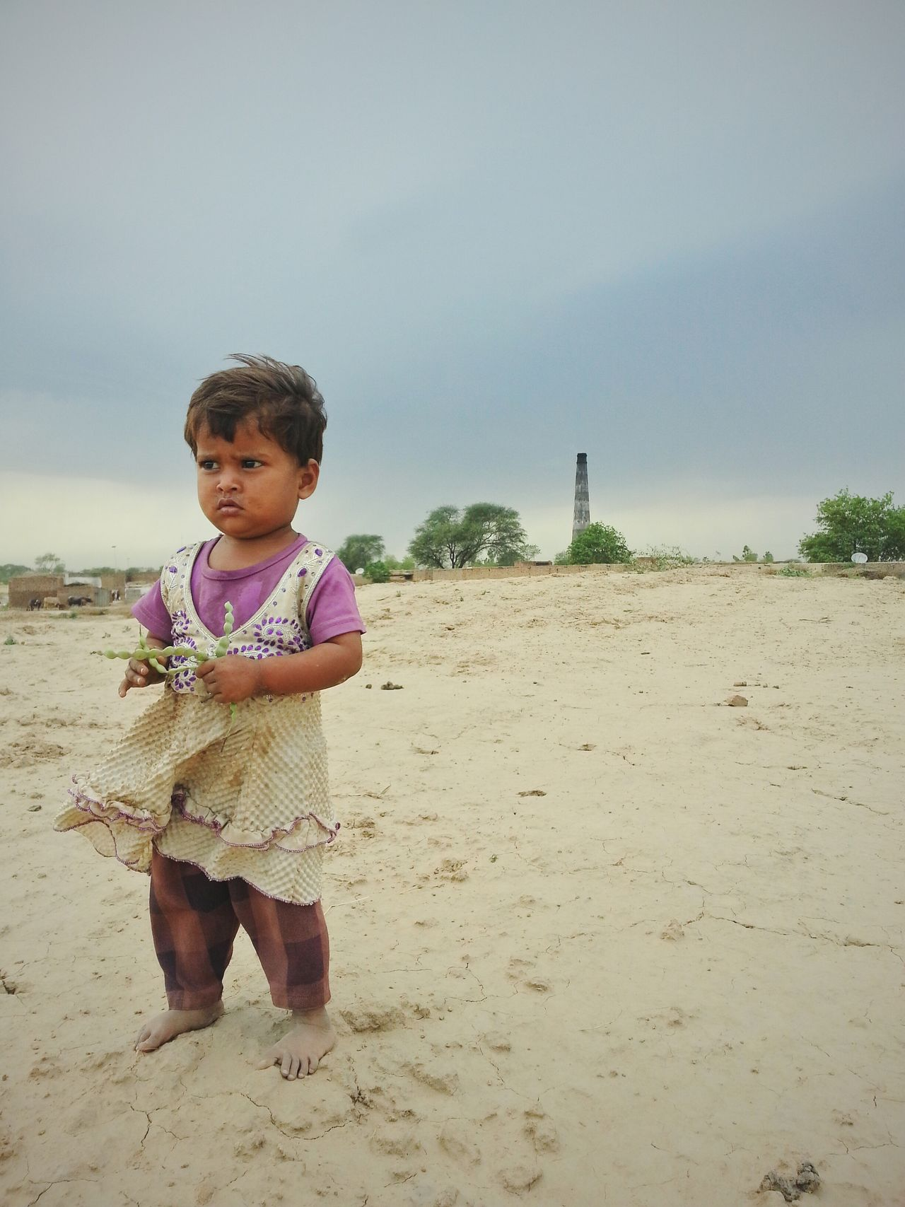 Art Is Everywhere Sand Children Only Full Length Childhood One Person Child People Summer Fun Beach Day Cute Standing Outdoors Portrait Sky Happiness Males  Smiling One Boy Only Poor Children Poor Life Poor Kid Helplessness The Photojournalist - 2017 EyeEm Awards Place Of Heart