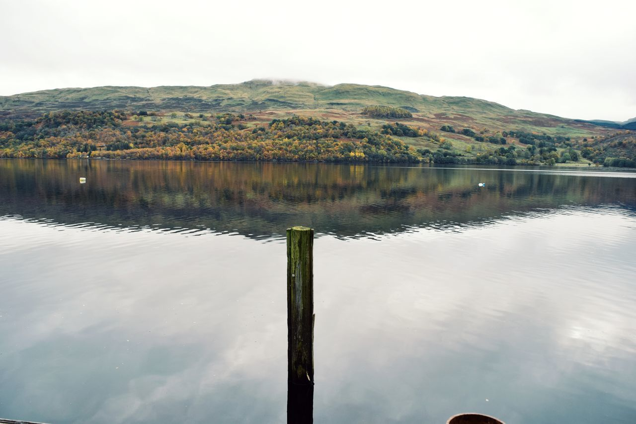All alone Water Reflection Lake Nature Outdoors Landscape No People Grass Sky Tree Day EyeEm Landscape Beauty In Nature Scotlandsbeauty Autumn🍁🍁🍁 Scotland Mountain Loch  Loch Tay Clouds Mist