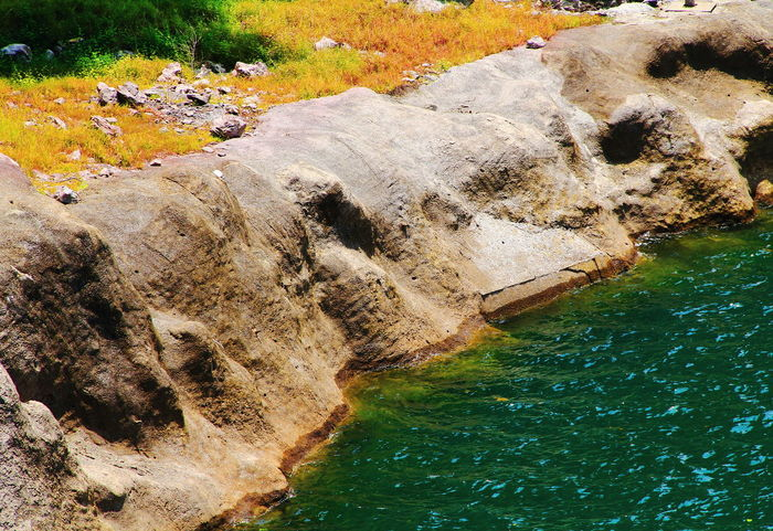river bank in shiny day Background Bank Beauty In Nature Day Emerald Lake Emerald Water Holiday Lake Land Landscape Nature Ocean Place Relax River Bank  Rock Rock - Object Rock Formation Scenery Scenic Sea Tourist Attractions View Point Wallpaper Water