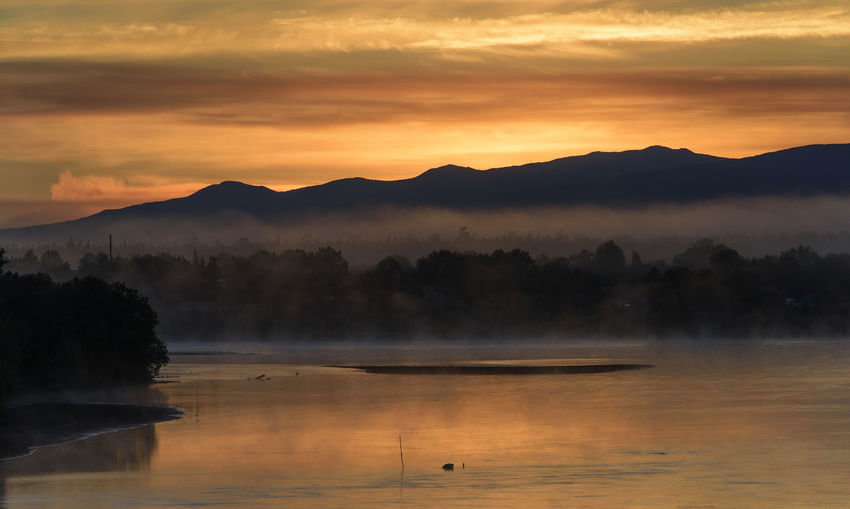 Golden sunrise over a misty river Beauty In Nature Cloud - Sky Day Far East Kamchatka Landscape Mountain Nature No People Outdoors Reflection Russia Scenics Sky Sunset Tranquility Tree Water