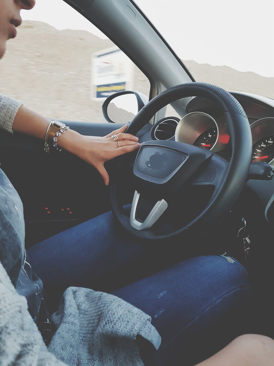steering wheel, transportation, one person, real people, car interior, travel, day, sitting, human hand, outdoors, people