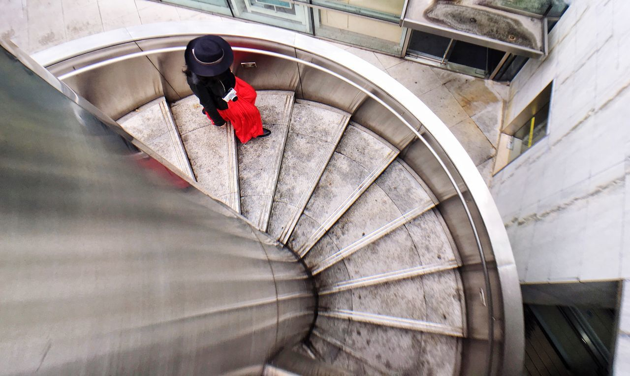 Steps And Staircases Railing Staircase Steps Built Structure Low Angle View Spiral Staircase Architecture Stairs Rainy Days IPhoneography Travel China Casual Clothing Red Dress Hat Day Adults Only