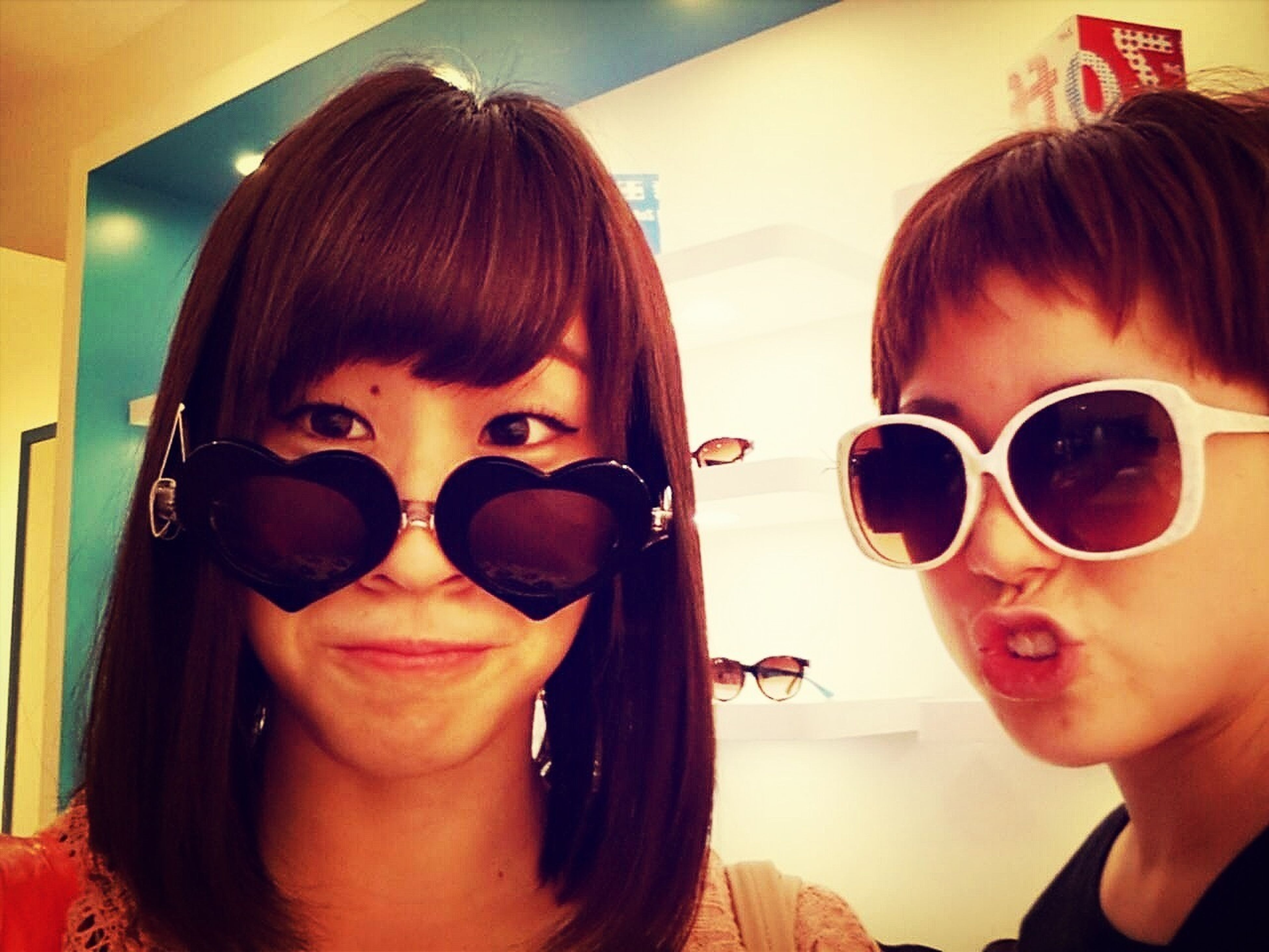 person, young adult, headshot, lifestyles, leisure activity, sunglasses, portrait, young women, looking at camera, head and shoulders, close-up, front view, indoors, smiling, car, transportation