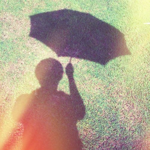 The Shadow That Holds An Umbrella Will Not Get Wet On A Sunny Day: A Self-Portrait