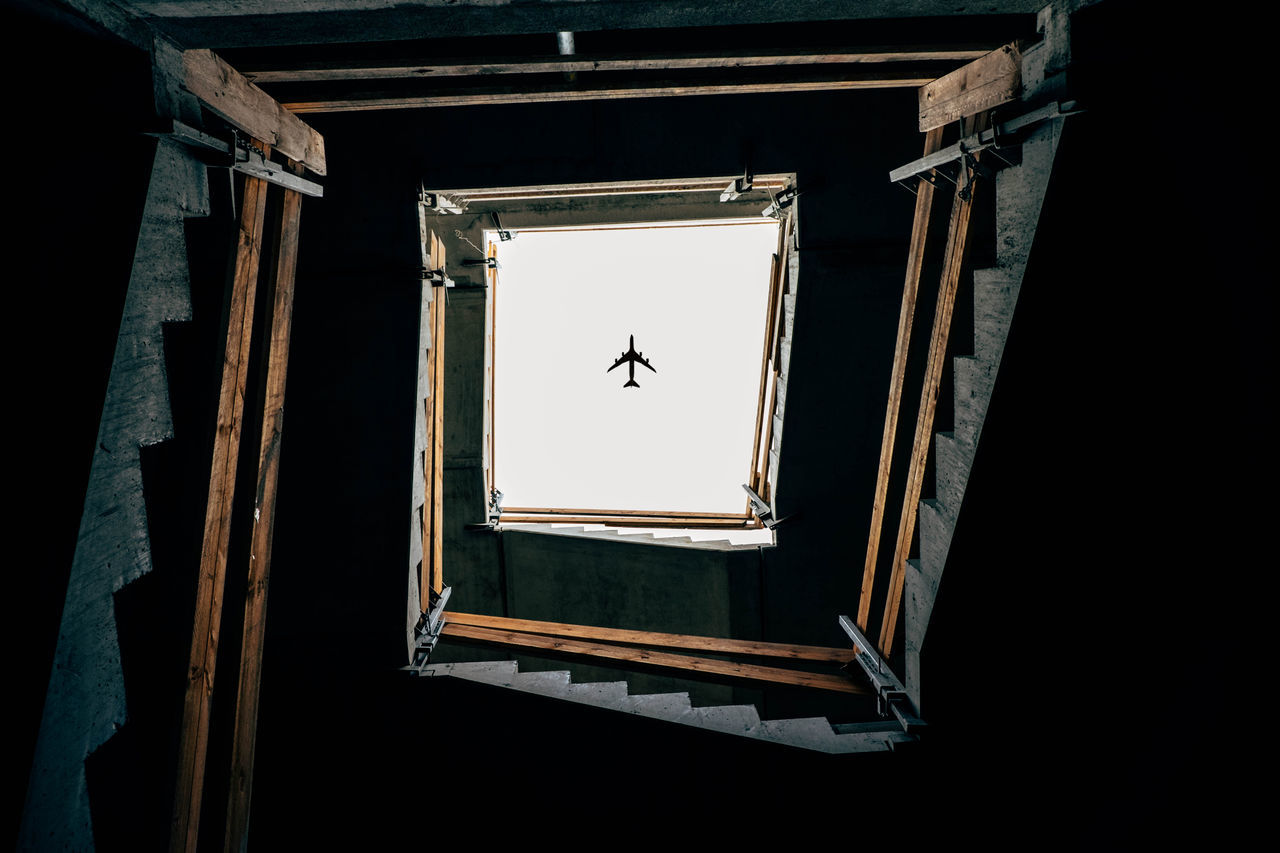landingzone Airplane AirPlane ✈ Animal Themes Artistic Dark Day Drone  Flying Indoors  Lights Lookingup No People One Animal Plane Shadows Sky Stairs Street Photography Streetphotography Wing Wood WOW EyeEmNewHere The Architect - 2017 EyeEm Awards