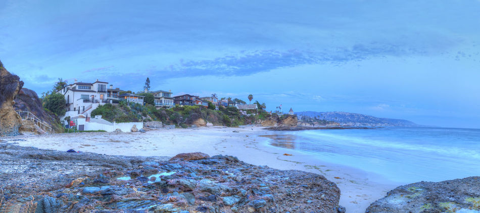 Sunset over the rocks at Shaws Cove in Laguna Beach as water flows over the stone in HDR Caifornia Cliffs Day Laguna Beach Nature Ocean Outdoors Palm Trees Rocks Sea Shaws Cove Sky Sky And Clouds Sunset Tropical United States Water