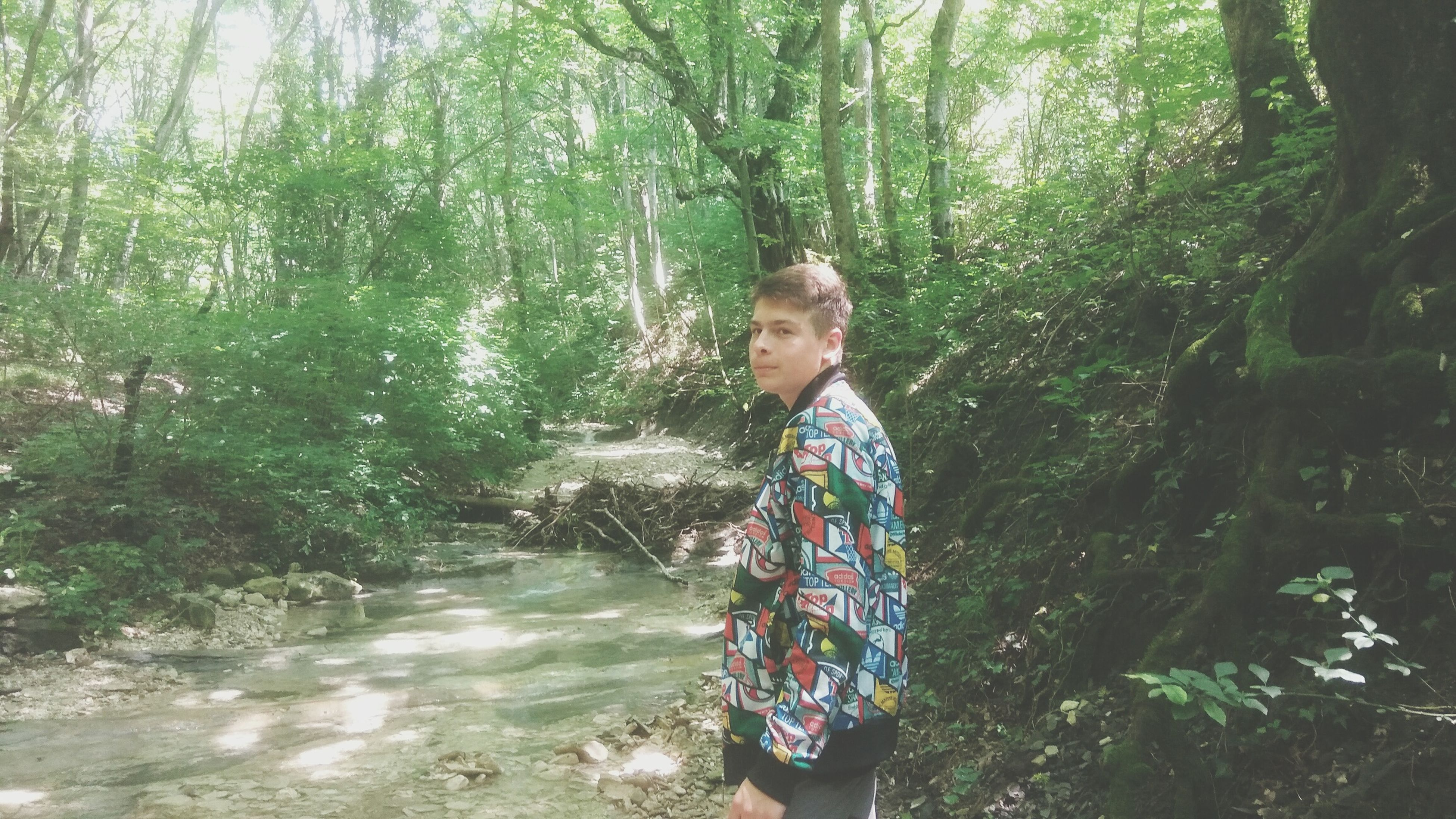 tree, forest, real people, young adult, one person, nature, day, outdoors, leisure activity, lifestyles, standing, young women, casual clothing, young men, growth, plant, smiling, happiness, scenics, beauty in nature, water, people