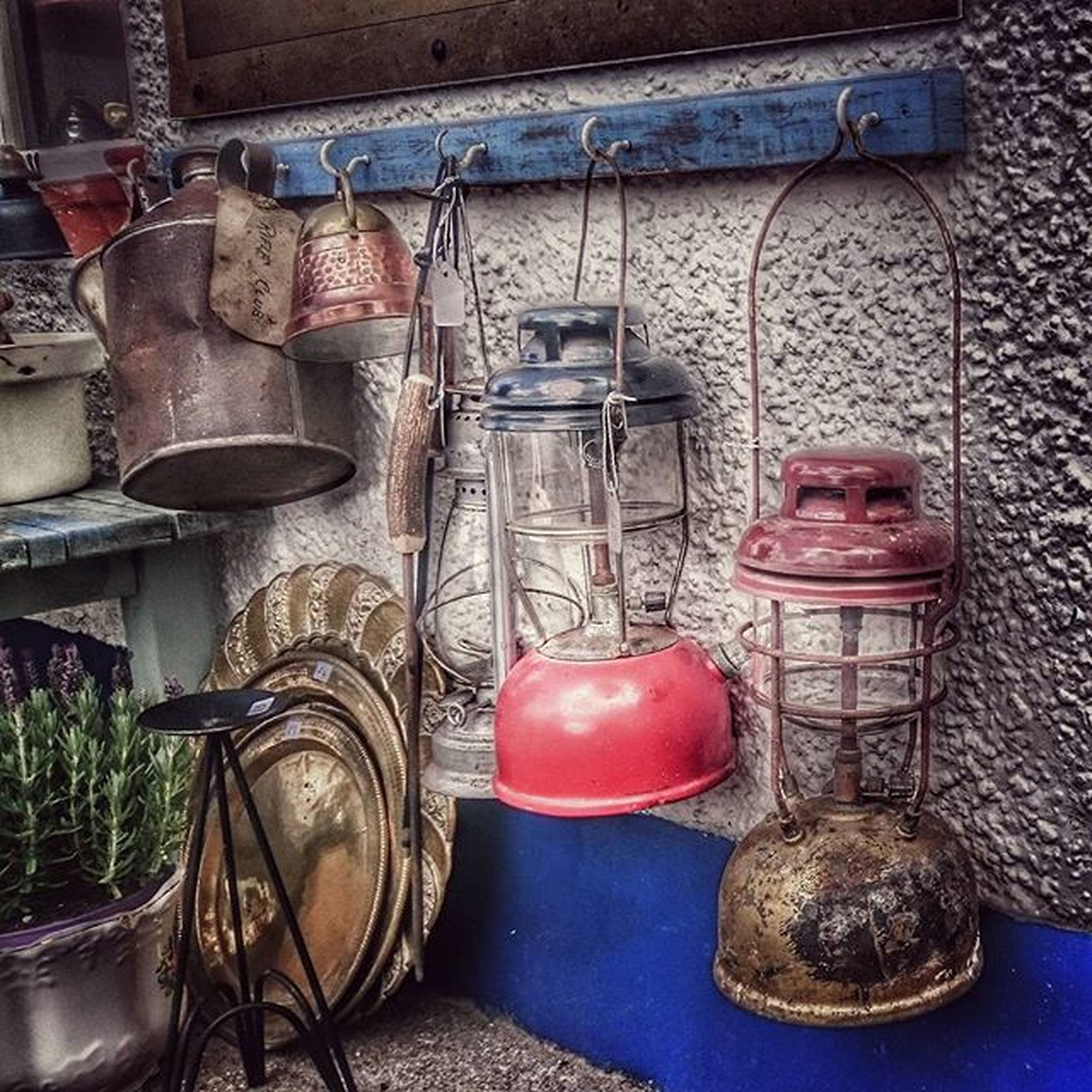 indoors, still life, table, large group of objects, variation, high angle view, container, no people, arrangement, abundance, choice, group of objects, food and drink, chair, basket, absence, metal, retail, day, freshness