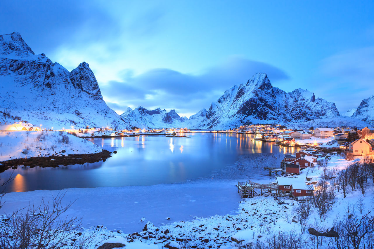 The fisherman village Reine on Lofoten Islands by night, Norway Beauty In Nature Blue Cold Temperature Day Frozen Iceberg Lake Landscape Mountain Mountain Range Nature No People Outdoors Reflection Scenics Sky Snow Snowcapped Mountain The Fisherman Village Reine On Lofoten Islands By Night, Norway Tranquil Scene Tranquility Water Winter