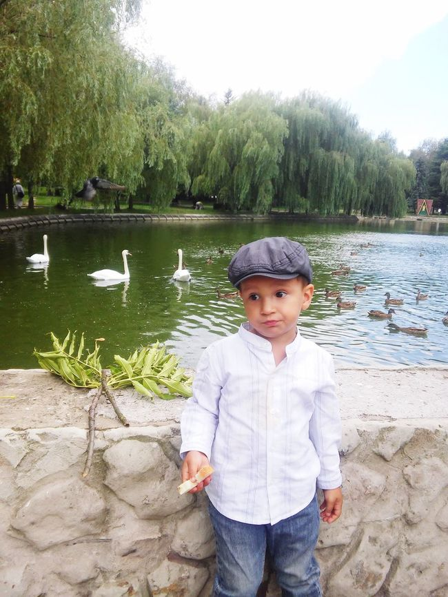 Water Tree Childhood Standing Lake Casual Clothing Model Shoot Cute Baby Hat Elementary Age Lifestyles Pond Person Front View Nature Looking At Camera Day Tranquil Scene Beauty In Nature Tranquility Scenics