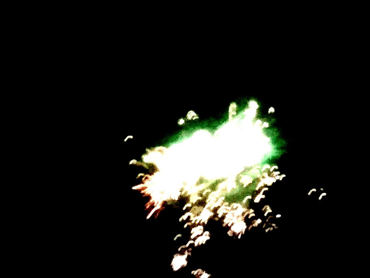 exploding, firework display, firework - man made object, smoke - physical structure, celebration, explosive, black background, motion, arts culture and entertainment, no people, night, blurred motion, event, firework, illuminated, close-up, outdoors, talcum powder, sky