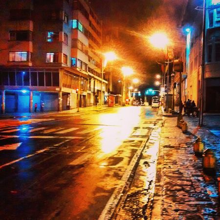 The Street Photographer - 2017 EyeEm Awards Night Illuminated Wet Building Exterior Architecture Street Weather City Built Structure Winter City Street No People Outdoors Road Water Cold Temperature