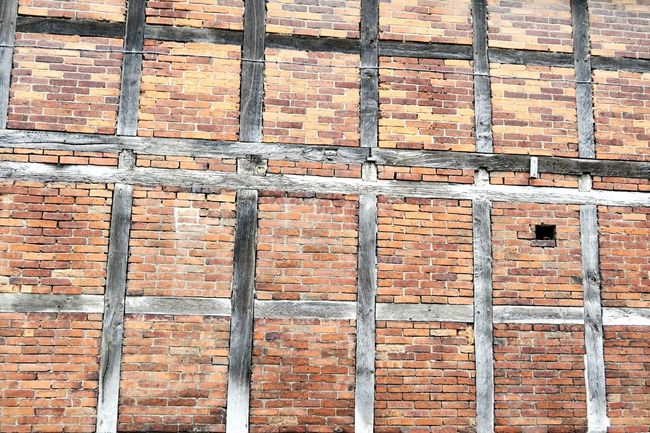 half-timbered house made of brickstones. background. Fassade Brick Background Brick Wall Brickstones Brickporn Brickswork Brick Background Bricks Halftimbered Half-timbered Houses Half-timbered Half-timbered House