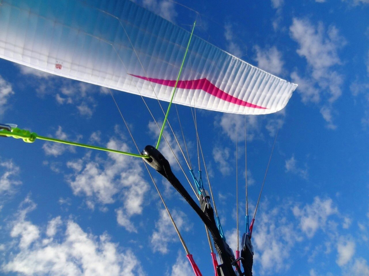 low angle view, sky, cloud - sky, day, outdoors, blue, adventure, nature, parachute, no people, extreme sports, vapor trail