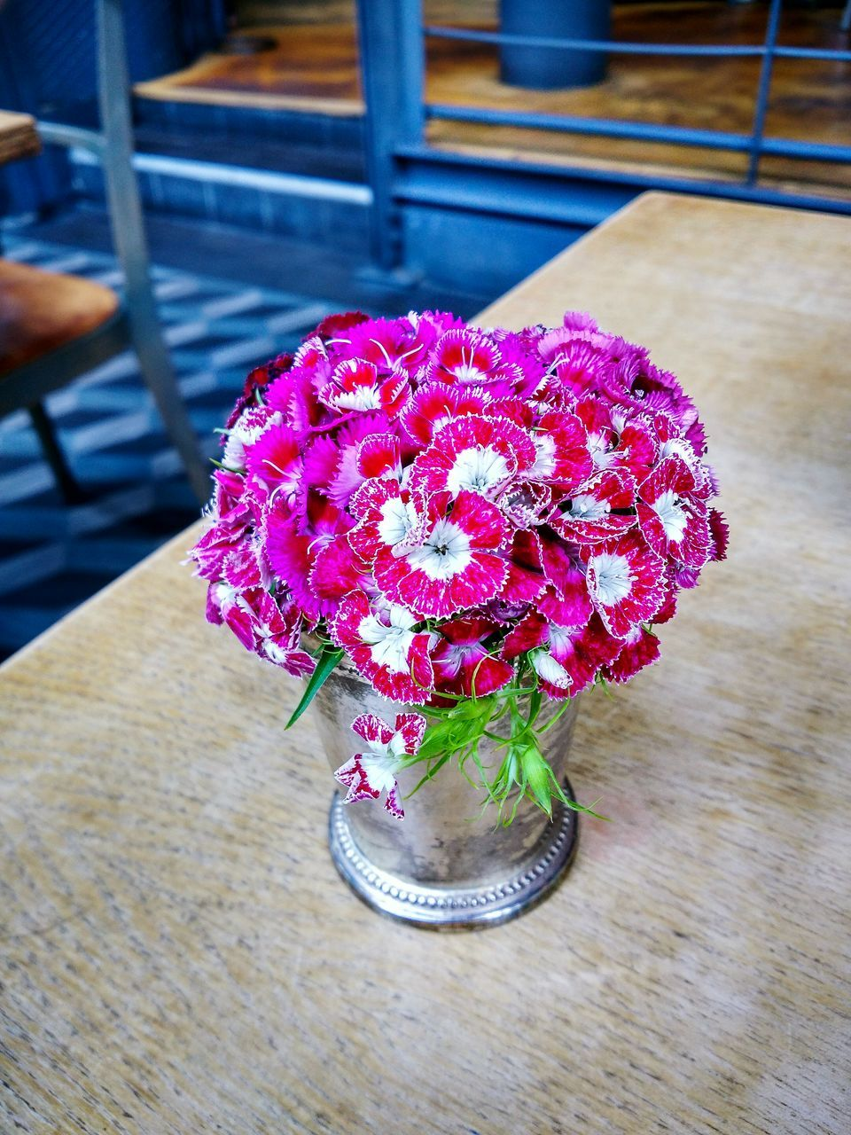 flower, table, freshness, indoors, no people, fragility, vase, high angle view, close-up, wood - material, nature, pink color, flower head, day, beauty in nature