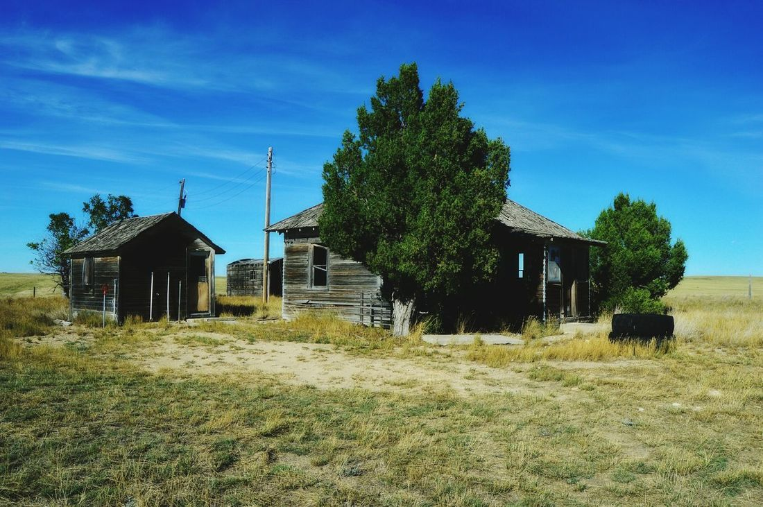 Abandoned ranch Prairie Center Wyoming Along Country Road No Trespassing Out In The Boondocks Sun Shining Brightly Nearest Ranch House Over A Mile Away No People Beautiful Summer Day