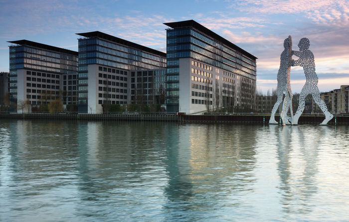 Berlin Treptow Berlin Hochhäuser Molecule Man Architecture Beauty In Nature Building Exterior Built Structure City Day Full Length Lifestyles Nature One Person Outdoors People Real People Reflection River Sky Treptow Water Waterfront Wohnen Women Young Adult