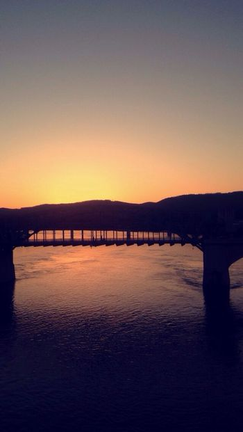 Sunset Water Built Structure Connection Silhouette Architecture Bridge - Man Made Structure River Scenics Waterfront Bridge Clear Sky Orange Color Tranquil Scene Engineering Tranquility Mountain Calm Mountain Range Beauty In Nature