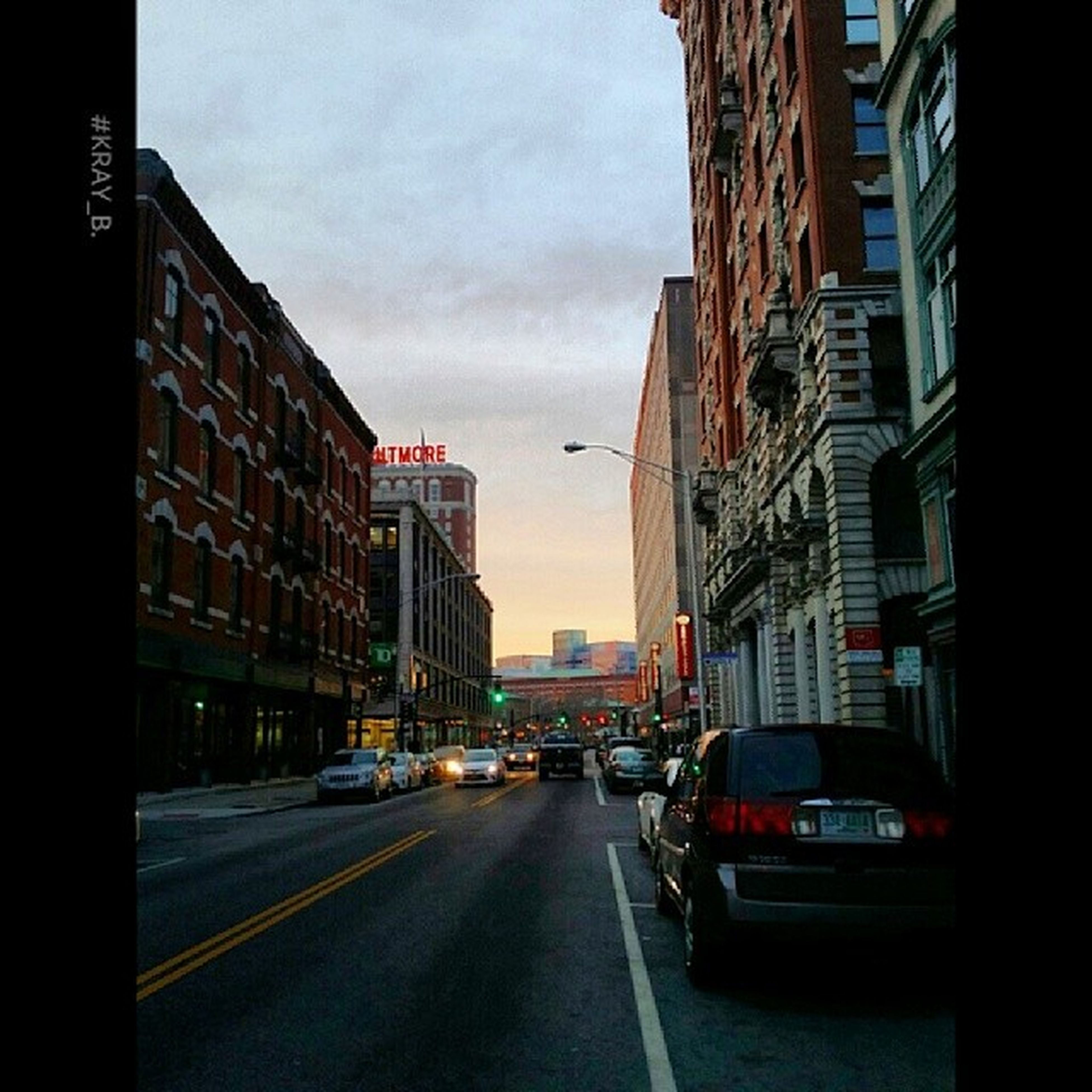 building exterior, architecture, transportation, car, built structure, land vehicle, city, mode of transport, street, road, sky, the way forward, building, city life, city street, diminishing perspective, incidental people, road marking, traffic, residential building