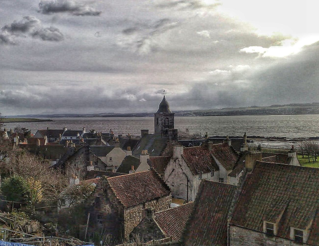 A view from behind Culross Palace, looking towards the bay. Culross is a small village in Fife believed to originally have been founded in the 6th century by Saint Serf. There is a whole host of beautiful old buildings and the town has a long history. It was once a major port although the original harbour has long gone. Worth a look in Google maps though as you can see where the harbour once was. Scotland Sea Outdoors Fife