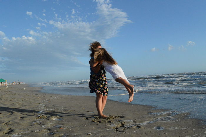 Beach Cloud Coastline Day Horizon Over Water Hug Jump Love Sea Shore Sky Water People And Places Enjoy The New Normal