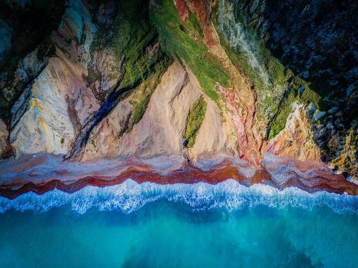 Alum Bay, Isle of Wight from above :) Rock - Object Rock Formation Nature Geology Beauty In Nature Tranquility Multi Colored Landscape No People Scenics Outdoors Sand Day Isleofwight UK 🇬🇧 Aerial View Drone  Dji Art Abstract Photooftheday ArtWork UK Landscape Sea And Sky Sea