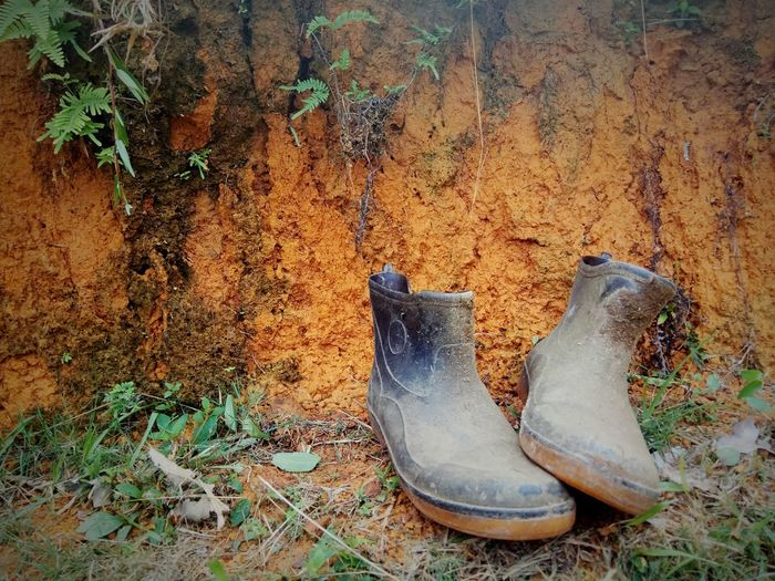 no matter how hard.. Rubber Boot Shoe Pair Outdoors Sand Nature Close-up Rubber Grass No People Working Time