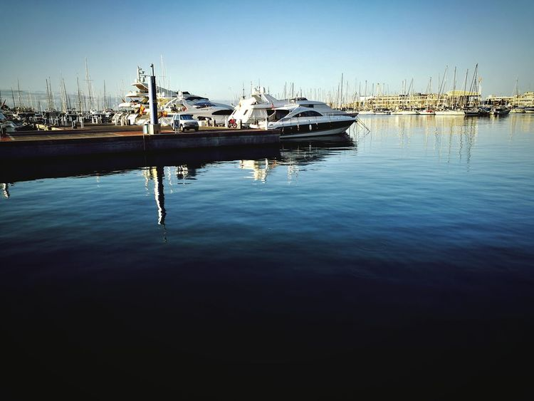 EyeEm Selects puerto de Alicante Reflection Sky Tranquil Scene Outdoors Water Tranquility Travel Destinations No People Nautical Vessel Blue Nature Day Sea Building Exterior Harbor Clear Sky City Beauty In Nature