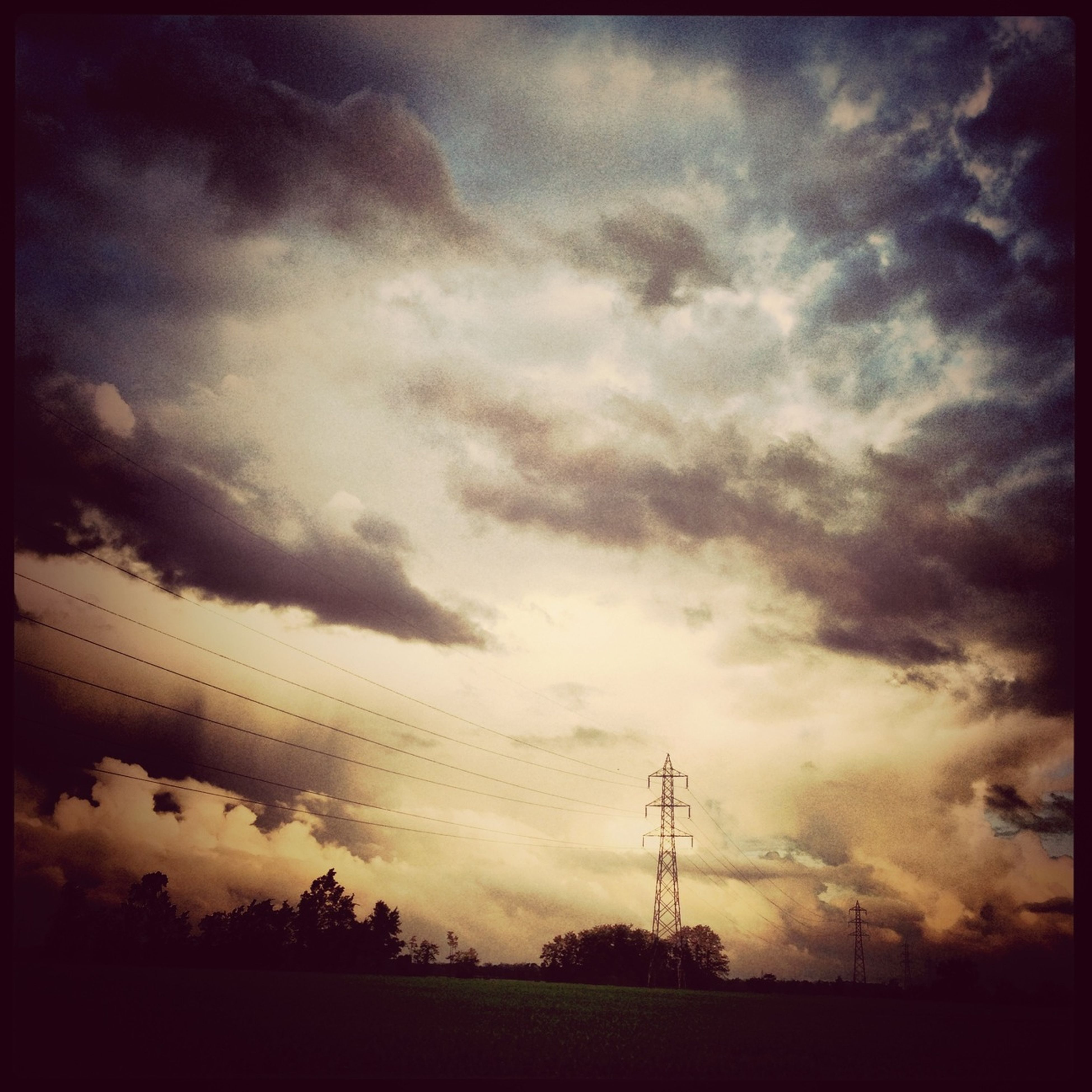 sky, cloud - sky, power line, electricity pylon, cloudy, low angle view, silhouette, electricity, power supply, connection, fuel and power generation, cloud, beauty in nature, scenics, sunset, tranquility, overcast, weather, nature, tranquil scene