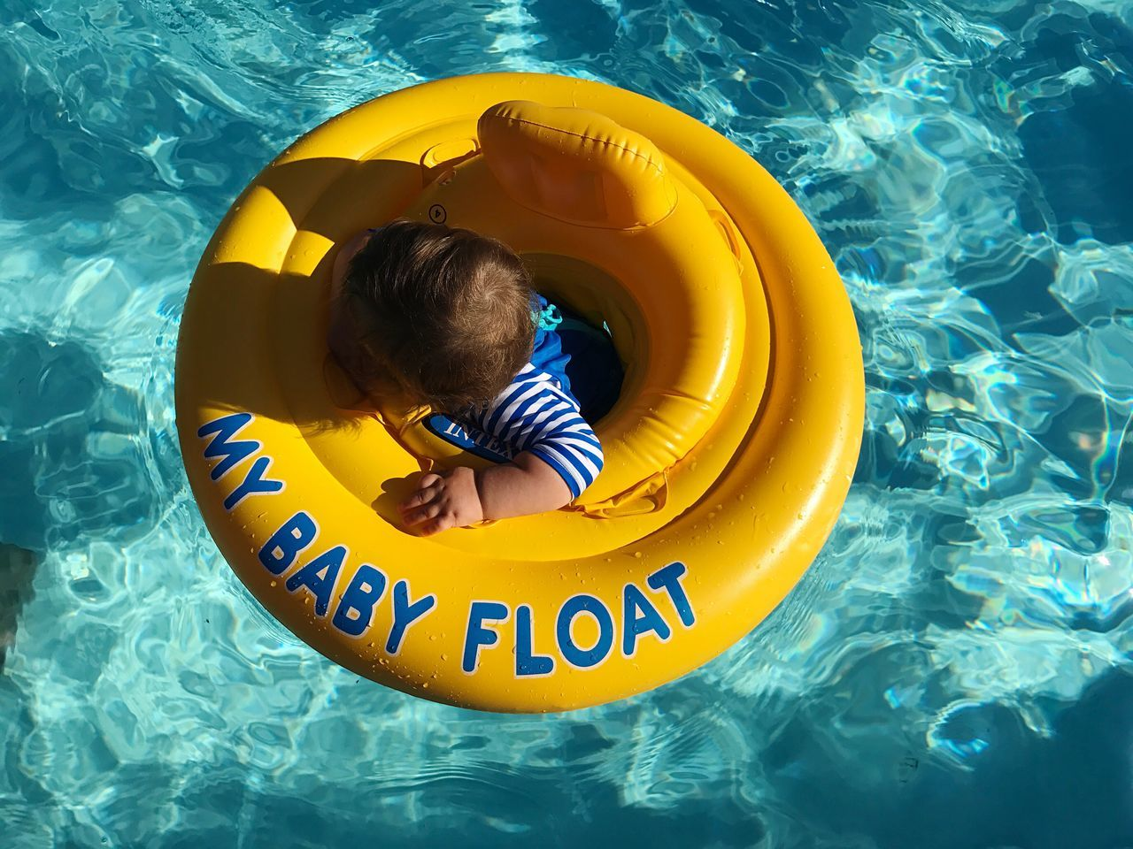 Childhood Swimming Pool Inflatable Ring One Person Water Day Pool Raft Leisure Activity Real People Playing Yellow Boys Outdoors Child Water Slide People