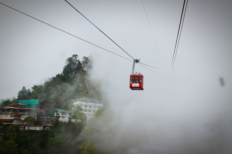 Overhead Cable Car Red Fog No People Mode Of Transport Ski Lift Sky Clouds And Sky Transportation Nature Viewfromthetop Amezing Peack Gangtok,India Houses On A Hill Break The Mold Neighborhood Map Live For The Story EyeEm Selects Shades Of Winter