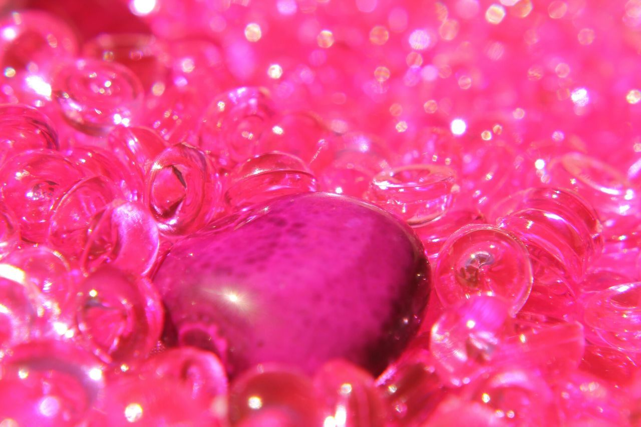 Close Up Of Pink Glass Beads And Stone