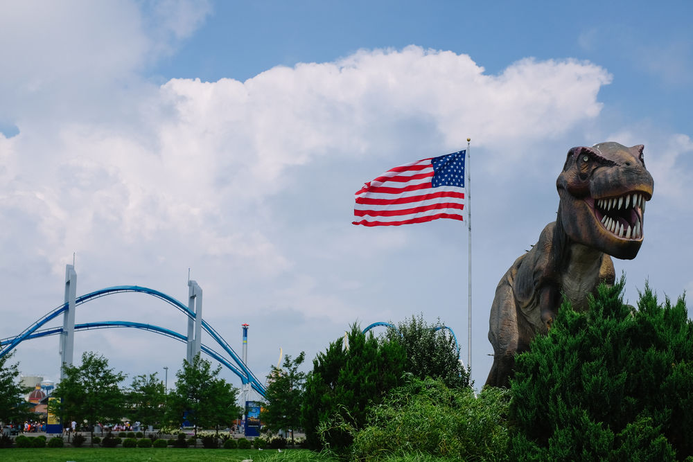 Cedar Point Cloud - Sky Day Dino Dinosaur Extreme Flag Flag Pole Low Angle View Nature No People Outdoors Park Patriotism Roller Roller Coaster Rollercoaster Sculpture Sky Stars And Stripes Statue Travel Tree USA USA FLAG