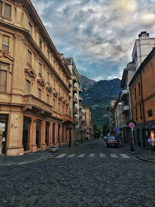 Italian street Street Car City Mountain Diminishing Perspective Aosta Alps Rocky Mountains Building Outdoors