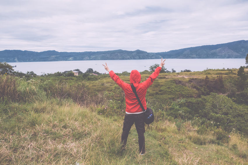 man standing on hill looking at the lake toba Field Freedom Retro Toba Tourist Travel Beauty In Nature Cloud - Sky Day Field Forest Grass Hand Raised Happiness Hiker Hill Lake Landscape Leisure Activity Lifestyles Meadow Men Mountain Mountain Range Nature One Person Outdoors Real People Scenics Sky Standing Summer Traveler Vintage Young Adult