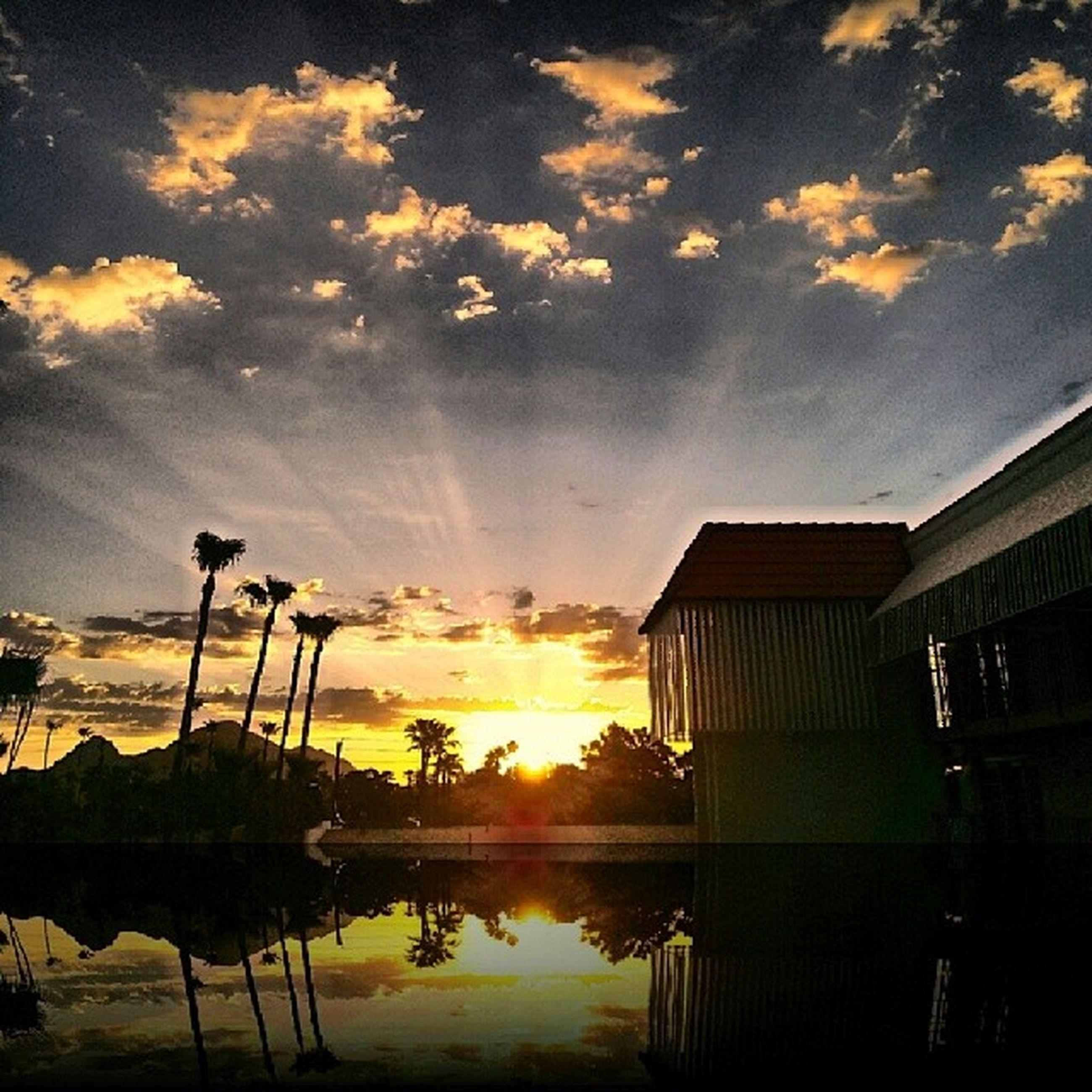 sunset, water, sky, reflection, cloud - sky, sun, orange color, scenics, beauty in nature, built structure, tranquility, architecture, nature, tranquil scene, cloud, cloudy, idyllic, sunlight, sea, building exterior