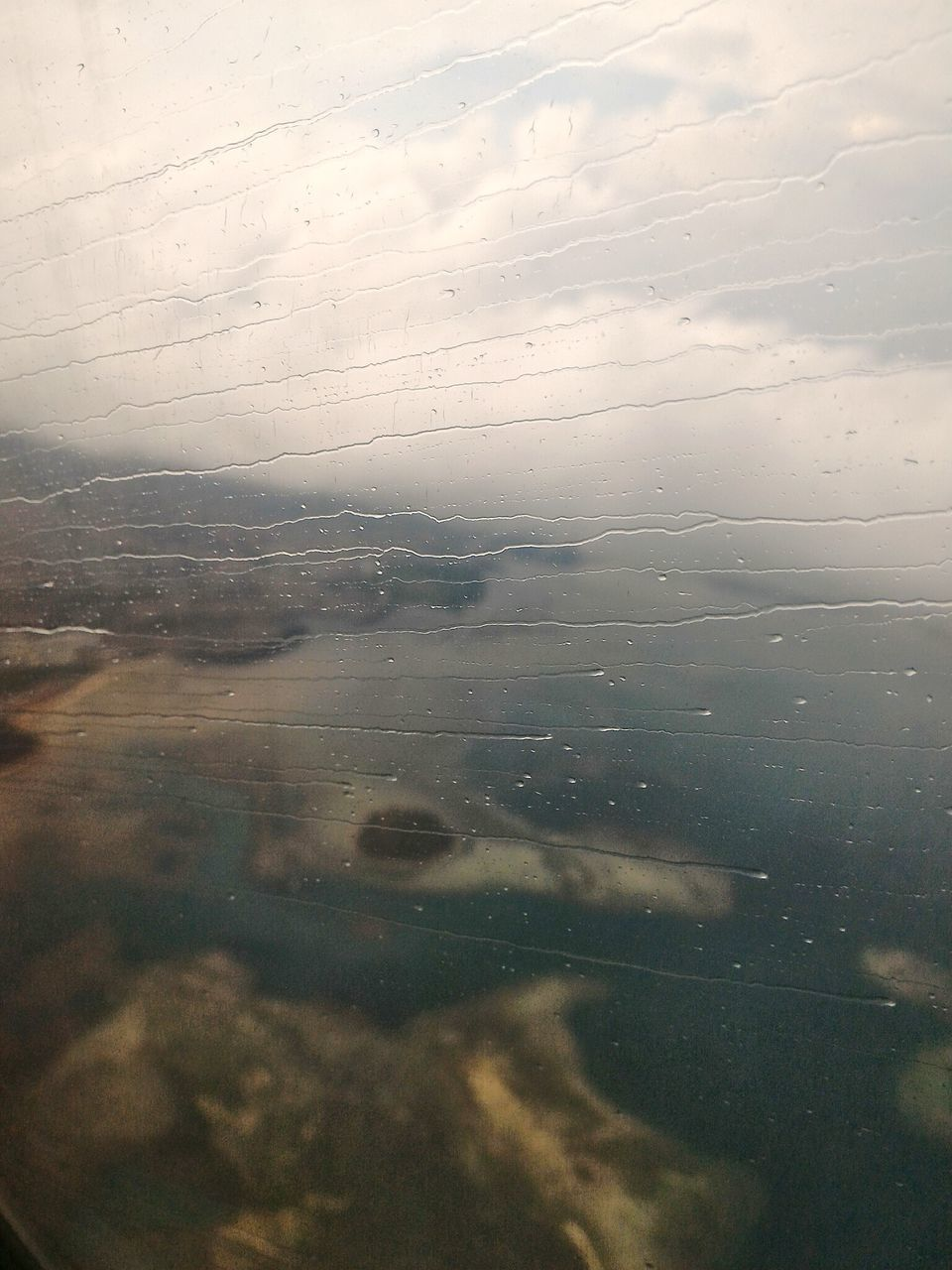 View From Airplane Window During Monsoon