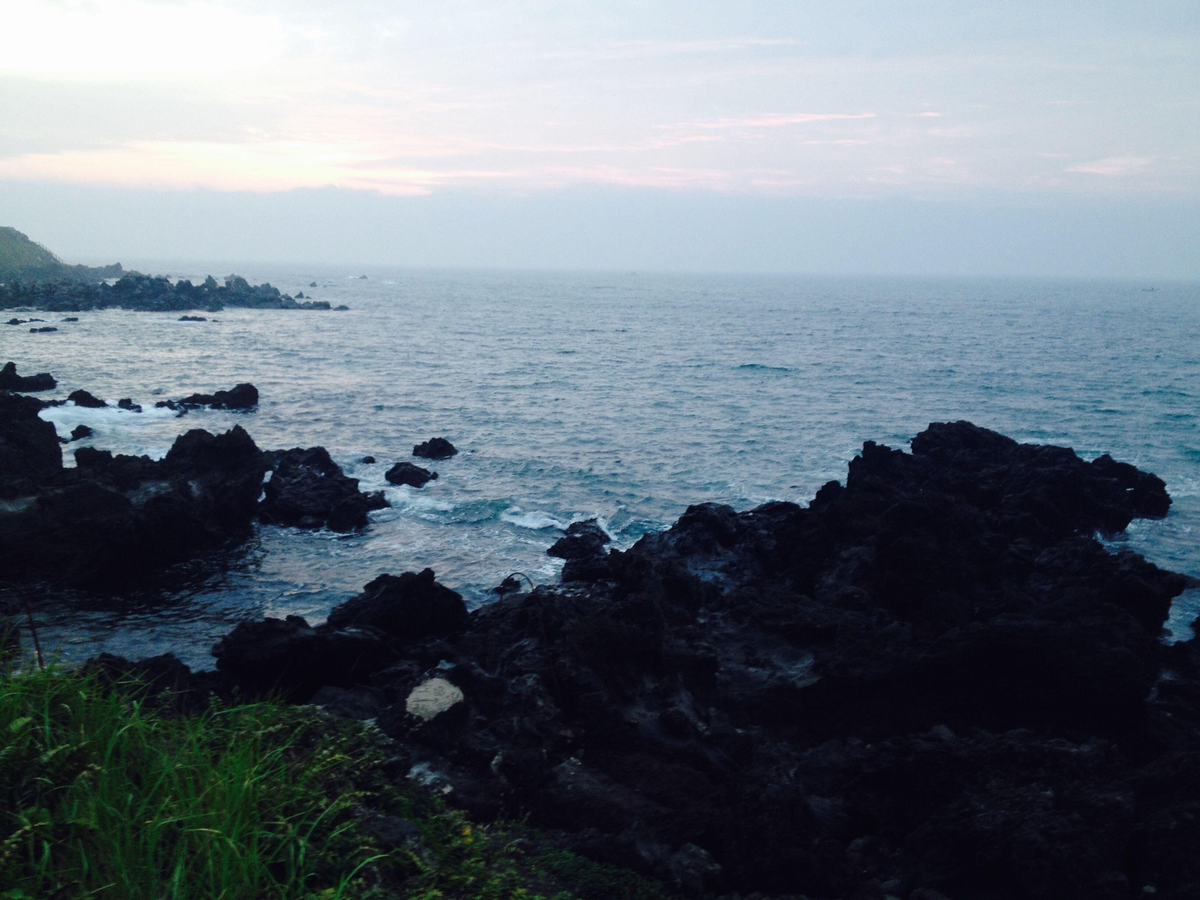 sea, water, horizon over water, scenics, tranquil scene, tranquility, beauty in nature, sky, rock - object, nature, rock formation, rock, idyllic, cliff, coastline, shore, beach, remote, outdoors, non-urban scene