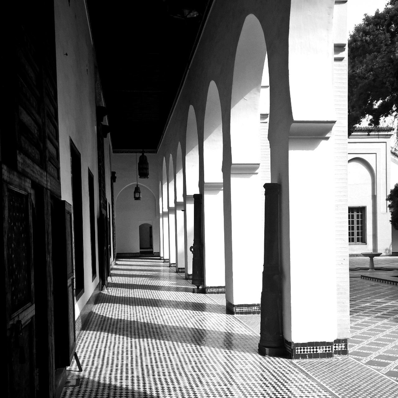 architecture, corridor, built structure, arch, architectural column, indoors, the way forward, day, no people, building exterior