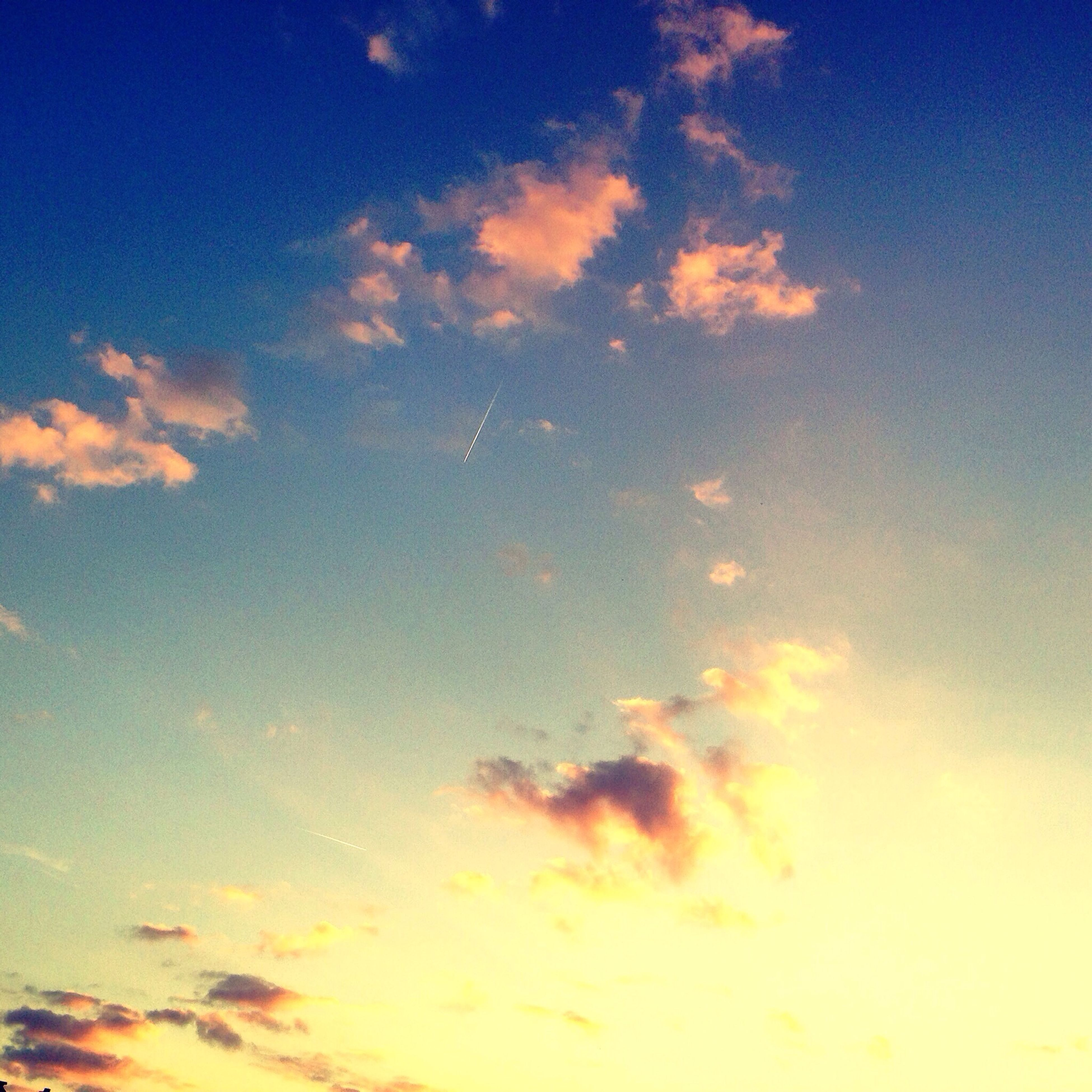 sky, low angle view, beauty in nature, cloud - sky, tranquility, blue, scenics, tranquil scene, sky only, sunset, nature, backgrounds, idyllic, cloud, cloudscape, full frame, outdoors, cloudy, orange color, no people