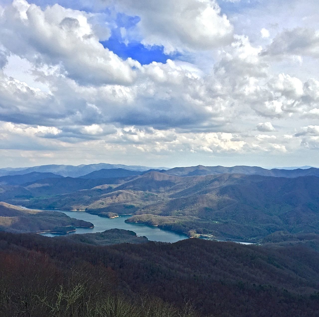 View of Fontana Lake from the Shuckstack Firetower on the Appalachian Trail in Smoky Mountain National Park Adventure Appalachian Trail Backpacking Beauty In Nature Clouds Cloudy Fontana Lake Hiking Lake Mountain Mountain Range Mountains Nature North Carolina Outdoors Shuckstack Firetower Sky Smoky Mountain National Park The Great Smoky Mountains Tranquility
