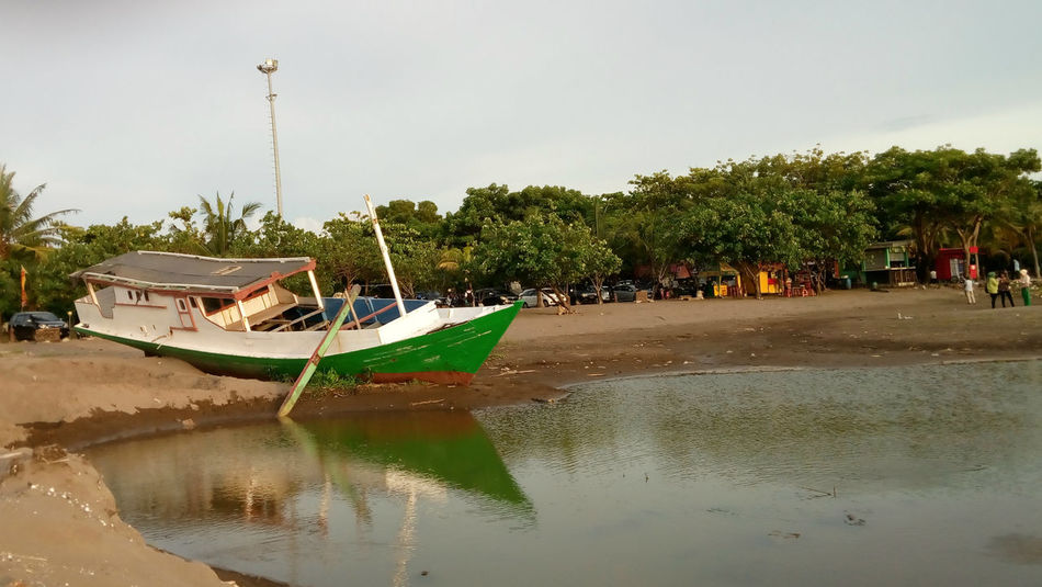 The green boat Beach Boat Landscape Mode Of Transport Photoshoot Ship Traditional Transportation Transportation