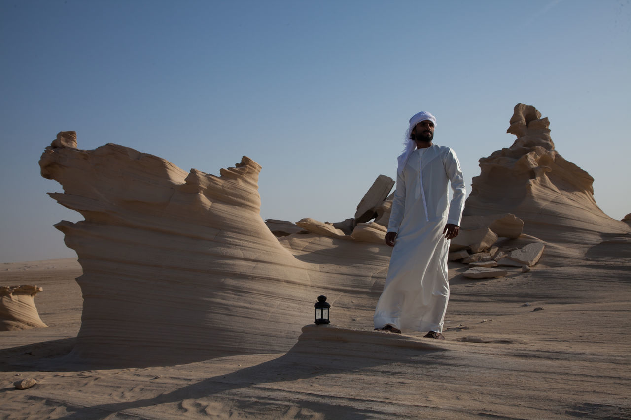 Ancient Civilization Arid Climate Beauty In Nature Clear Sky Day Full Length Leisure Activity Lifestyles Men Nature One Person Outdoors People Real People Sculpture Shadow Sky Standing Statue Sunlight Travel Destinations Women Young Adult