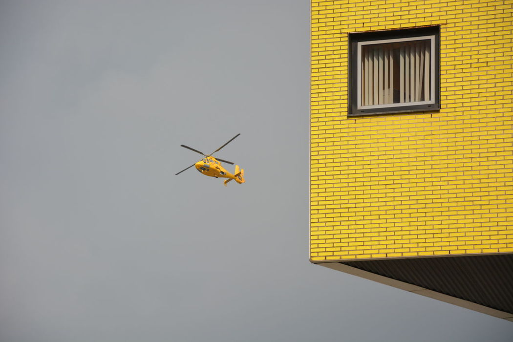 lifeliner Rotterdam Building Emergency Flying Flyover Helicopter Helicopter Emergency Medical Service Lifeliner No People Rotterdam Stone Material Window Yellow Paint The Town Yellow