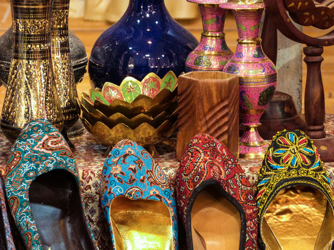 Abundance Arrangement Choice Collection Cultures Decoration For Sale Indoors  Iran Large Group Of Objects Market Market Stall Multi Colored No People Ornament Persian Repetition Retail  Shoes Souvenir Tradition Variation