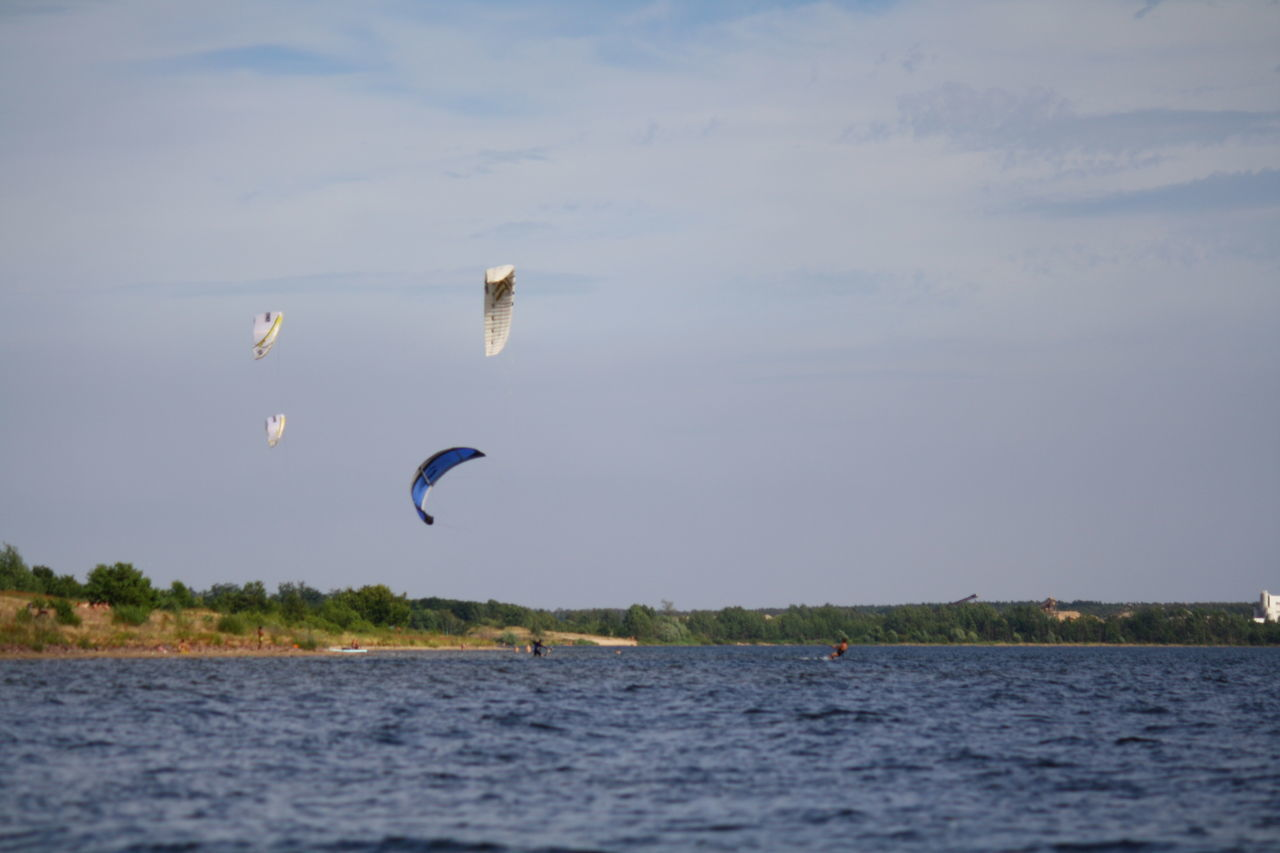 Beauty In Nature Blue Cloud Cloud - Sky Day Flying Freedom Idyllic Mid-air Nature No People Non-urban Scene Outdoors Rippled Scenics Sky Spread Wings Tranquil Scene Tranquility Water Sport Adventure Club Kitesurfing Kites