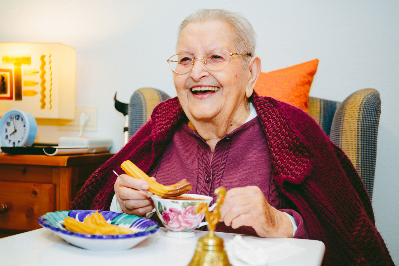 97th Birthday Adult Cheerful Chocolate Con Churros Domestic Life Eating Front View Grandma Gray Hair Happiness Headshot Indoors  Lifestyles Looking At Camera One Person One Senior Woman Only People Portrait Retirement Senior Adult Senior Women Smiling