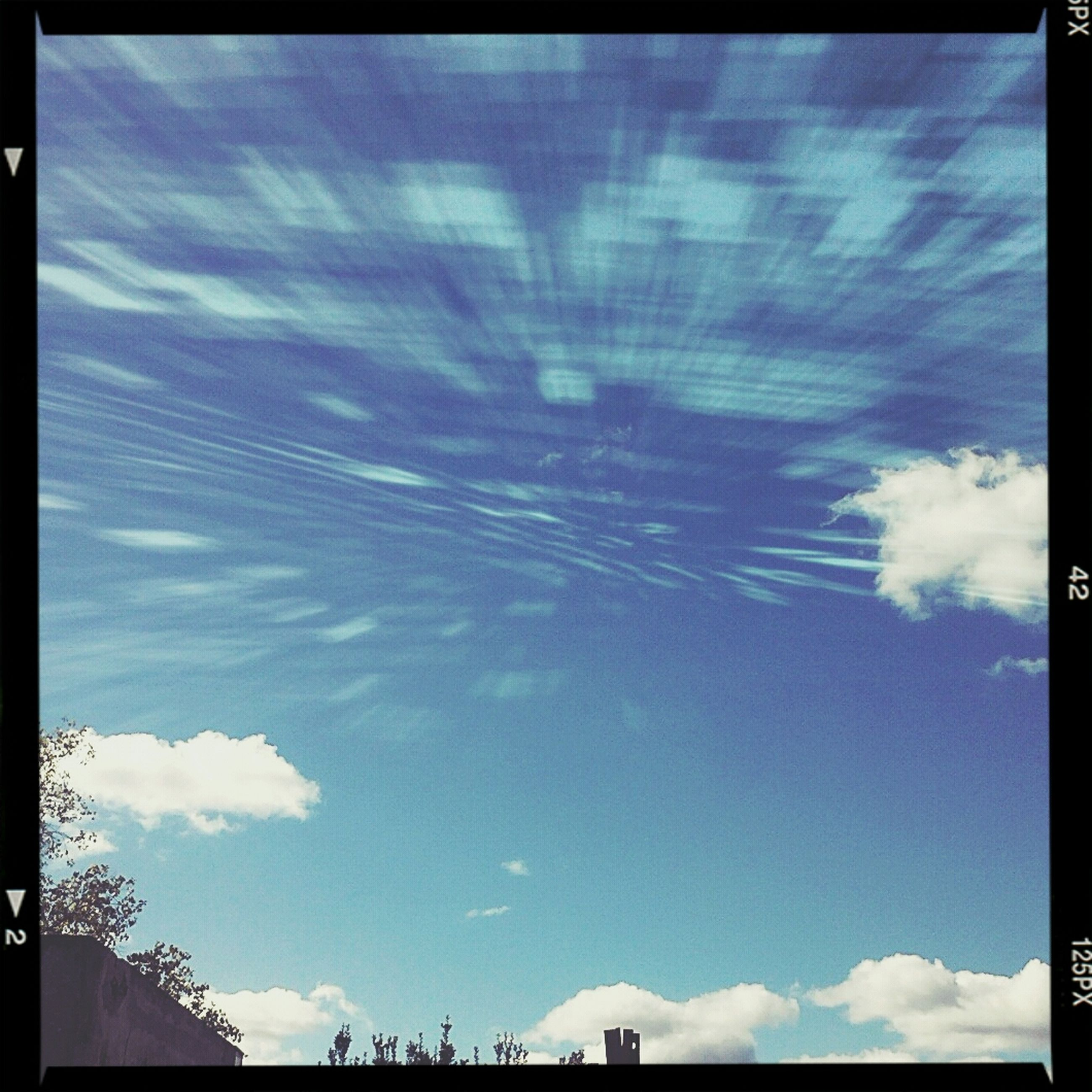 transfer print, sky, low angle view, auto post production filter, blue, cloud - sky, built structure, building exterior, architecture, sunlight, cloud, beauty in nature, nature, sunbeam, sun, outdoors, scenics, cloudy, no people, day