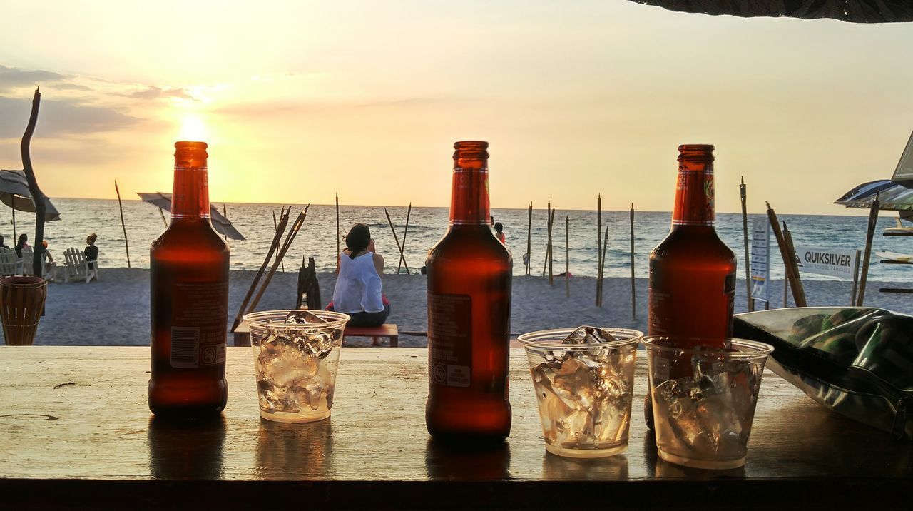 Enjoying beer and sunset Sunset Enjoying The Sun Liquid Lunch Drinking Under Sunset Chill By The Beach Life Is A Beach Sand And Surf Eyeem Philippines Loving Life  Wanderlust Chill Mode Friends And Beach  Beer With The Boys Food And Drink Beer Bottle